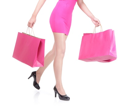 close up of happy shopping young woman running with color bags - isolated on white background, asian model Stock Photo - 21551611
