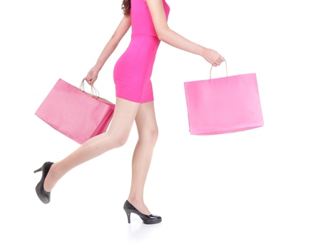 close up of happy shopping young woman running with color bags - isolated on white background, asian model photo