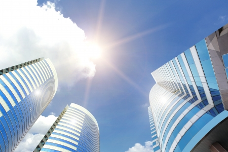 Modern business buildings with sun and sky photo