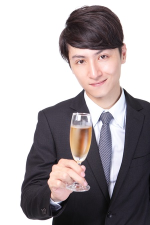 Successful business man toasting with Champagne isolated on white background, asian male model photo