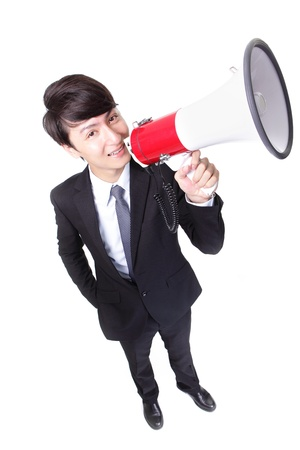 happy asian businessman using megaphone isolated on white background, high angle view photo