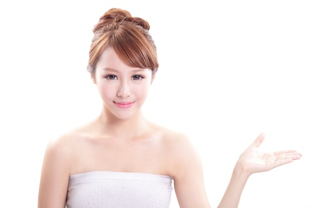 products: Beauty portrait of young woman showing beauty product  empty copy space with finger pointing, asian beauty