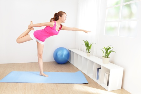 portrait of healthy young woman doing yoga at home in the morning, asian beauty photo