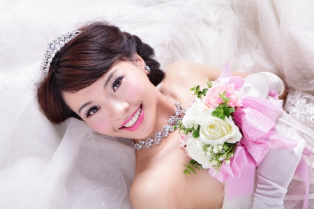 bridal hair: beauty portrait of bride with roses , asian woman beauty Stock Photo