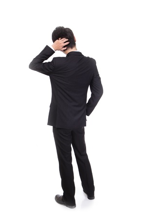 hands behind head: Rear view of young business man confused, isolated over white background, full length portrait of asian businessman standing back Stock Photo