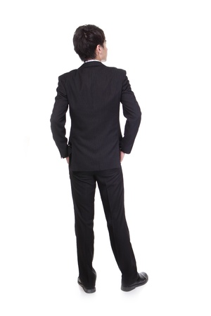 behind: business man from the back - looking at something isolated over a white background, asian male