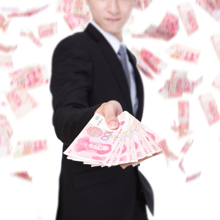 yuan: close up od business man hold China money ( Renminbi ) under a money rain, focus on hans - isolated over a white background, asian model