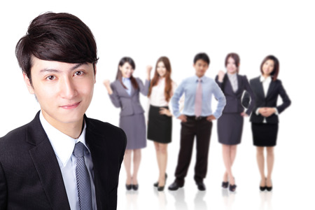 Young successful business man with group team behind him isolated on white background, asian model photo