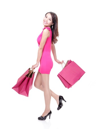 lady: happy shopping young woman running with color bags - isolated on white background, full body, asian model