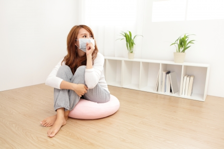 indoors: Sick Woman caught Cold and cough at home. asian female