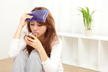 Sick Woman caught Cold and fever or Headache at home. asian female Stock Photo - 22504972