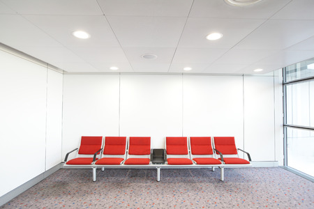 lounge chair: row of red chair at airport, shot in asia, hong kong