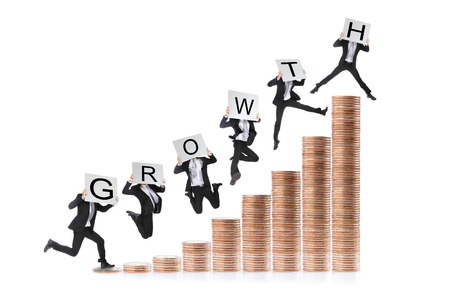 Growth - Business man happy  jumping or running on the money step and holding billboard with growth text Stock Photo - 22701485
