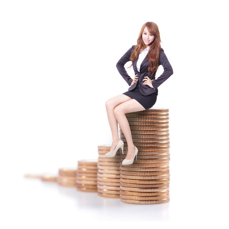 Happy business woman sitting on money stairs and look to you isolated against white background, business concept photo