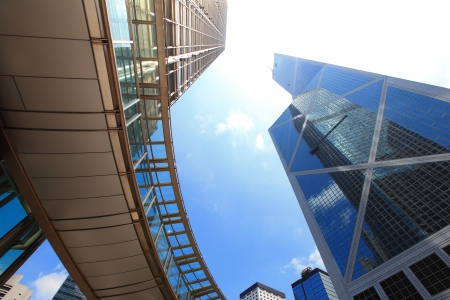 Modern business buildings with sun and sky, shot in hong kong, asia photo