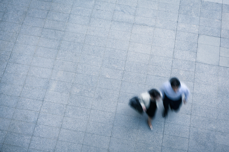 sidewalk talk: Business people walking and talking in the street, high angle view Stock Photo