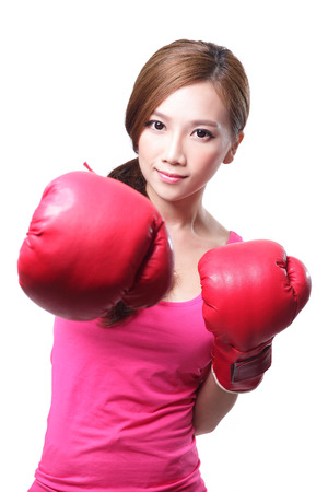 sport young woman with boxing gloves, face of fitness girl studio shot isolated over white background, asian beauty photo