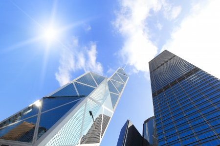 bank office: Modern business buildings with sun and sky, shot in hong kong, asia