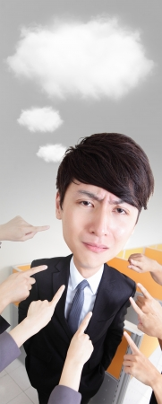 All hands finger pointing at a businessman at office, business concept, asian big head people photo