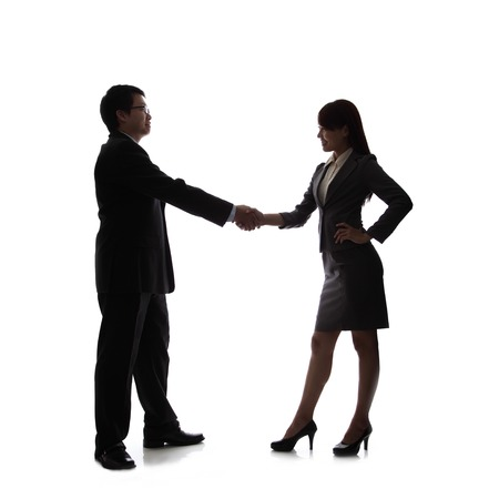 Silhouettes of Business team hand shake isolated on white background photo