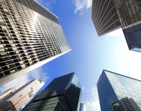 Modern business buildings with blue sky, shot in hong kong, asia photo
