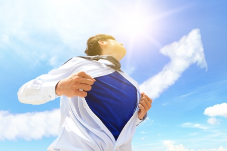 Business man pulling his t-shirt open, showing copy space with a superhero suit , sky and arrow cloud background photo