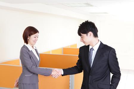 Happy smiling business team handshake at office, asian people photo