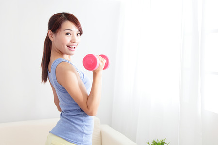 beautiful sporty woman working out with two dumbbells , asian beauty model Stock fotó - 23569043
