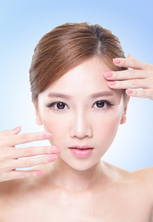 close up of attractive woman face with blue background, asian beauty photo