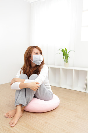 resting mask: Sick Woman. Flu. Woman Caught Cold. Headache. Virus .Medicines