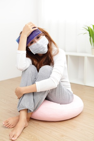 Sick Woman caught Cold and fever or Headache at home. asian female  photo