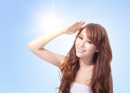 sunblock: Beautiful woman face with sunshine and blue sky, concept for skin care and sun block, asian beauty Stock Photo