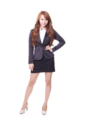 chinese business: Full length portrait of a confident young business woman standing isolated on white , asian beauty model