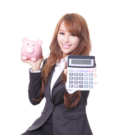 money box: Savings woman smiling holding pink piggy bank and calculator isolated on white . Asian girl