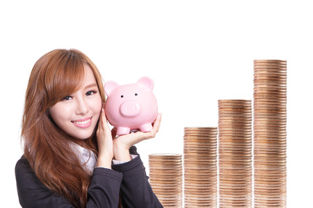 Business woman happy holding pink piggy bank with money stairs . Asian girl photo