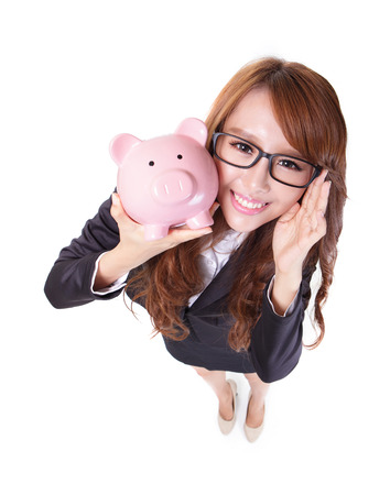 Savings woman smiling happy and holding pink piggy bank isolated on white background. Asian girl Stock Photo - 23958041