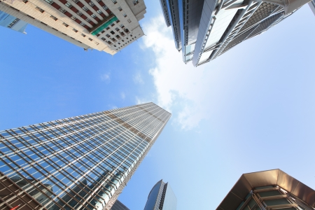business building: Modern business buildings with blue sky, shot in hong kong, asia