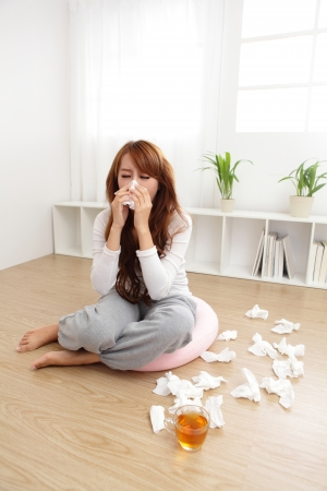resting mask: Sick Woman sneezing into Tissue. Flu. Woman Caught Cold. Headache. Virus .Medicines