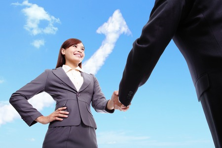 Success Business concept - Business woman and man handshake with arrow cloud and sky in the background, asian, hong kong photo