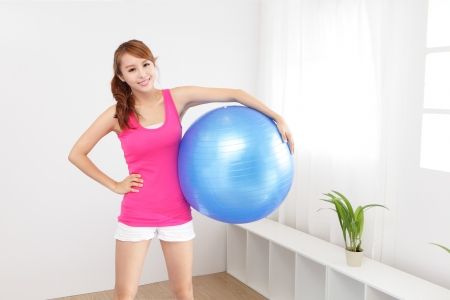fit ball: portrait of healthy young woman sport at home in the morning, asian beauty