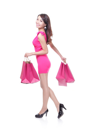 beautiful woman with many shopping bags photo