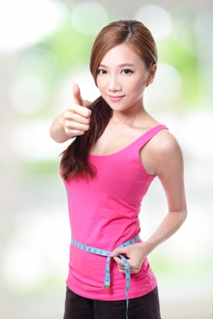 calory: sporty woman shapes and measure on white background Stock Photo