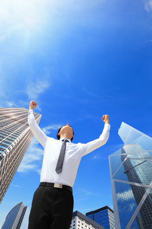 carefree business man arms up and looking to empty copy space with business building background, asian model, hong kong Stock Photo - 24455571