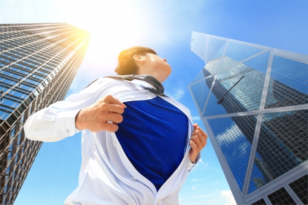 Business man pulling his t-shirt open, showing a suit with city building background, asian, hong kong