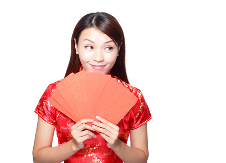 happy chinese new year. smiling asian woman holding red envelope Stock Photo - 24488019