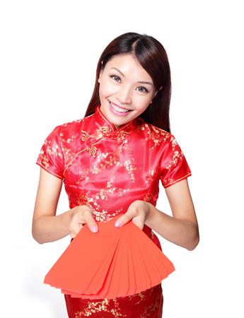happy chinese new year. smiling asian woman holding red envelope photo