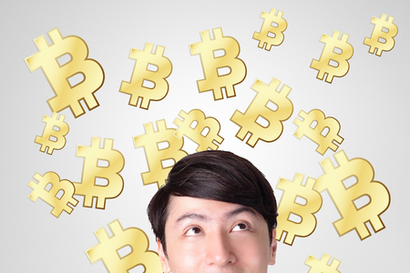 young man happy looking bitcoin, business and bitcoin concept photo