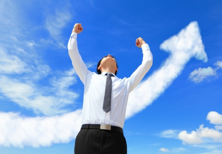 seeking solution: happy successful business man raised arms with arrow cloud, asian people Stock Photo