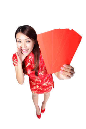 happy chinese new year. smiling woman holding red envelope, high angle view photo