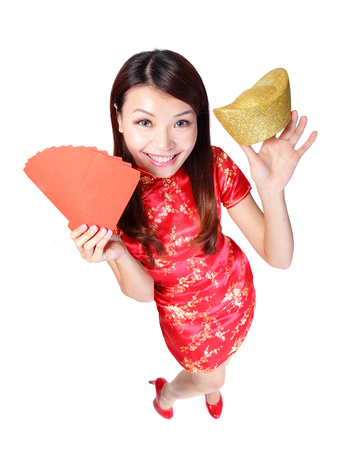 happy chinese new year. smiling asian woman showing gold for lucky. chinese mean get rich and happy photo